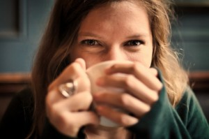 portrait-of-smiling-woman-drinking-coffee