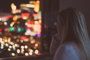 young-woman-watching-illuminated-city