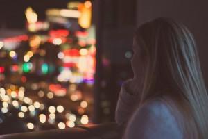 young-woman-watching-illuminated-city